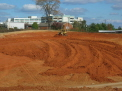Cat D6R pushing red clay