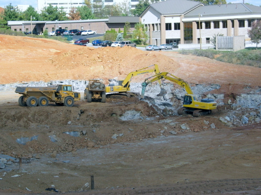 Removing rock from Retention basin